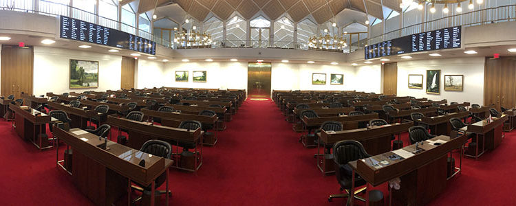 A view of the North Carolina General Assembly House Chamber from the rear of the room.